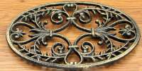 Oval Ornate Cast Iron Trivet