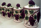 A Grapevine 4 Kitchen Canisters